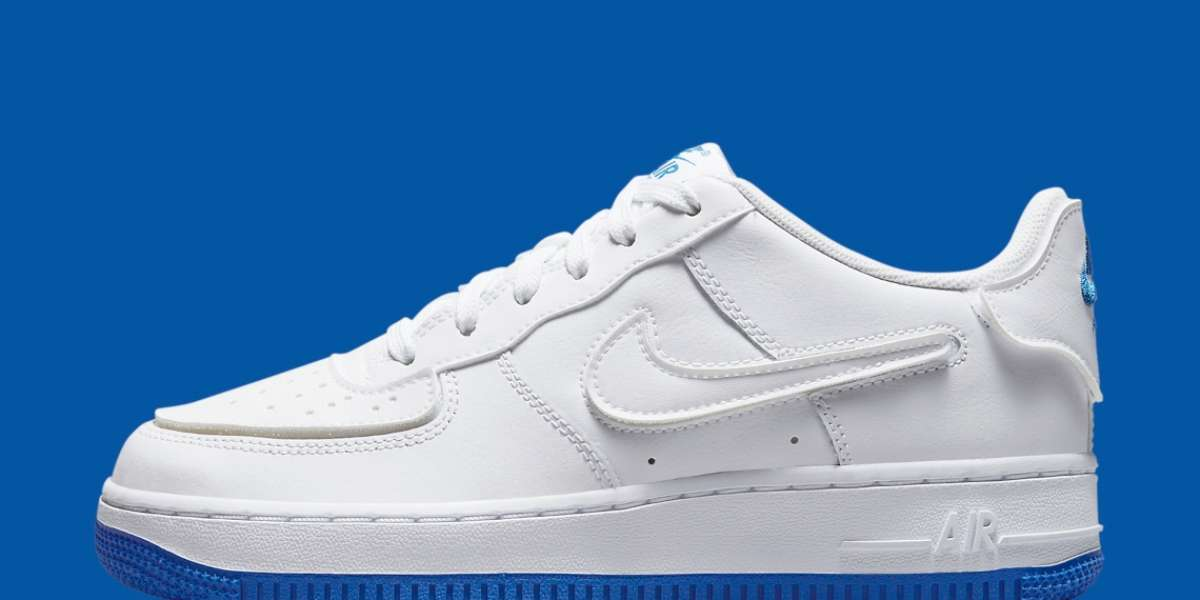 """DB4545-105 A child's Nike Air Force 1 has a """"Sapphire Blue"""" bottom and interchangeable soles"""